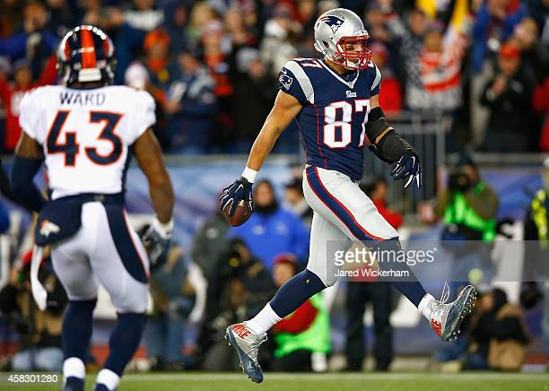 Rob Gronkowski of the New England Patriots reacts after scoring a touchdown during the fourth quarter against the Denver Broncos at Gillette Stadium...