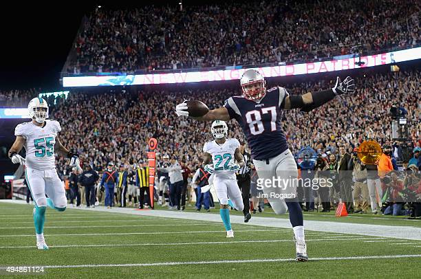 Rob Gronkowski of the New England Patriots reacts after scoring a touchdown during the first quarter against the Miami Dolphins at Gillette Stadium...