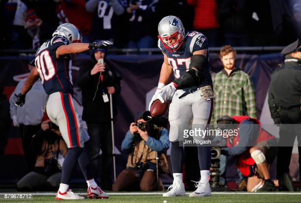 Rob Gronkowski of the New England Patriots reacts with Danny Amendola after catching a touchdown pass during the third quarter of a game against the...