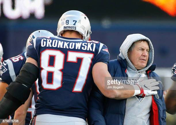 Rob Gronkowski of the New England Patriots reacts with head coach Bill Belichick after catching a touchdown pass during the third quarter of a game...