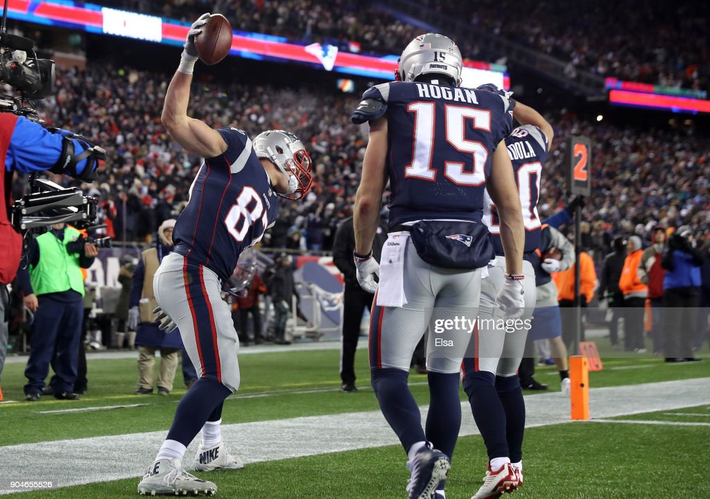 Rob Gronkowski #87 of the New England Patriots reacts with teammates after catching a touchdown pass in the fourth quarter of the AFC Divisional Playoff game against the Tennessee Titans at Gillette Stadium on January 13, 2018 in Foxborough, Massachusetts.