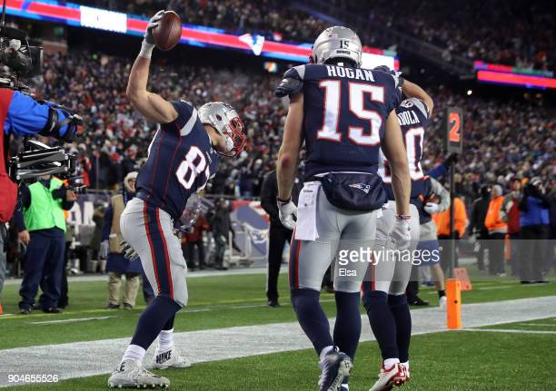 Rob Gronkowski of the New England Patriots reacts with teammates after catching a touchdown pass in the fourth quarter of the AFC Divisional Playoff...