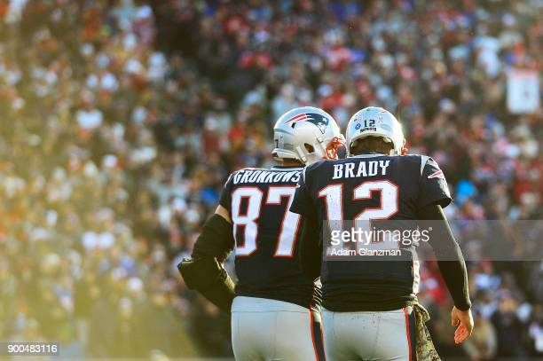 Rob Gronkowski of the New England Patriots reacts with Tom Brady after catching a touchdown pass during the third quarter of a game against the Miami...