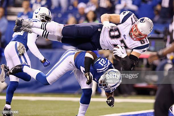 Rob Gronkowski of the New England Patriots scores a touchdown against Vontae Davis of the Indianapolis Colts during the fourth quarter of the game at...