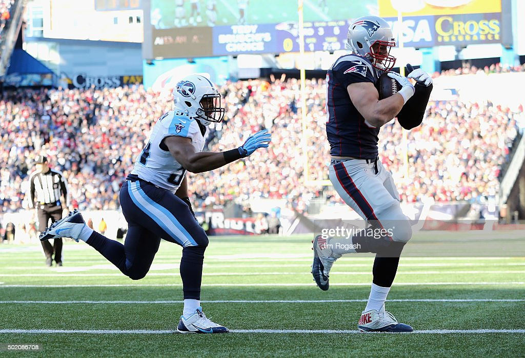 Rob Gronkowski #87 of the New England Patriots scores a touchdown during the first quarter against the Tennessee Titans at Gillette Stadium on December 20, 2015 in Foxboro, Massachusetts.