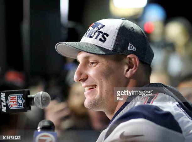 Rob Gronkowski of the New England Patriots speaks to the press during the New England Patriots Media Availability for Super Bowl LII at the Mall of...