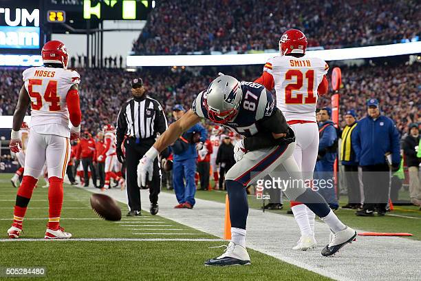 Rob Gronkowski of the New England Patriots spikes the ball after a touchdown catch in the first quarter against the Kansas City Chiefs during the AFC...