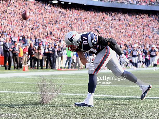Rob Gronkowski of the New England Patriots spikes the ball after scoring a touchdown against the Cincinnati Bengals in the third quater at Gillette...