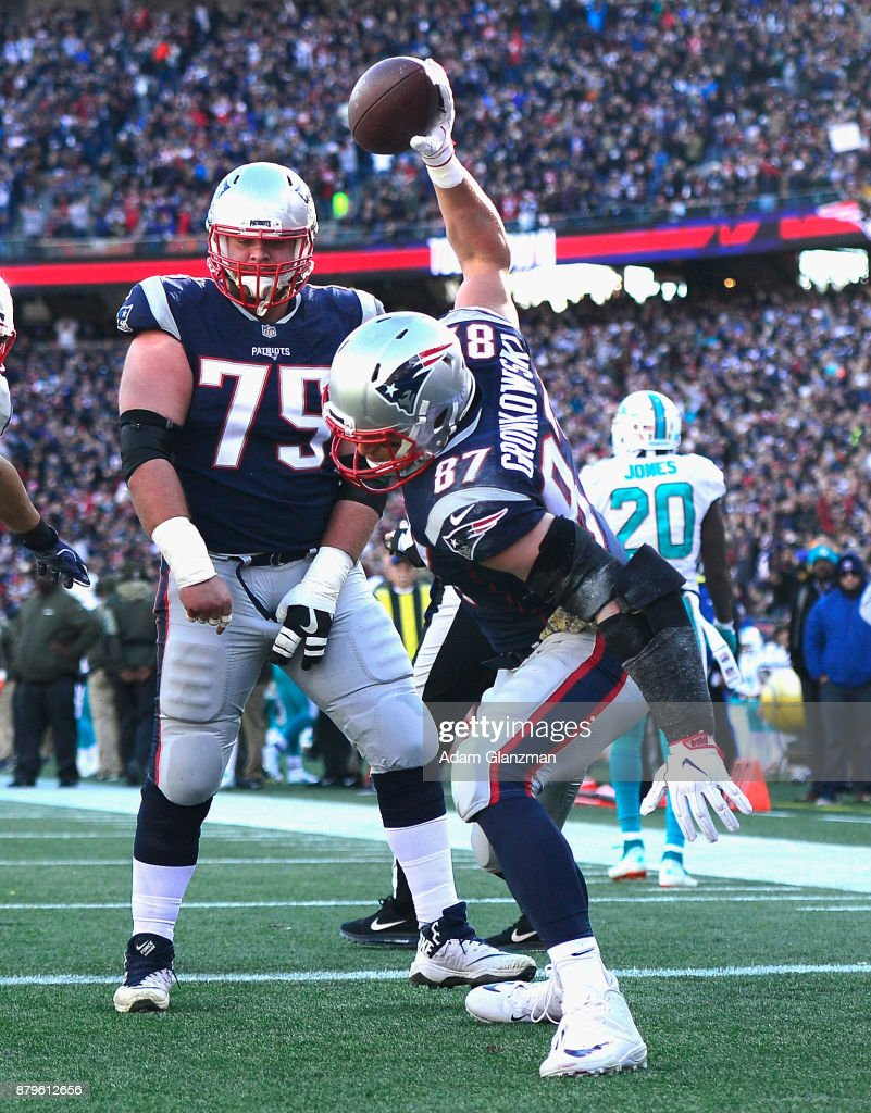Rob Gronkowski #87 of the New England Patriots spikes the ball after scoring a touchdown during the first quarter of a game against the Miami Dolphins at Gillette Stadium on November 26, 2017 in Foxboro, Massachusetts.