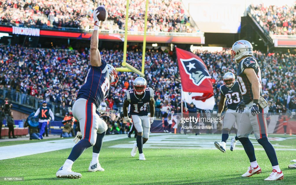 Rob Gronkowski #87 of the New England Patriots spikes the ball after catching a touchdown pass during the third quarter of a game against the Miami Dolphins at Gillette Stadium on November 26, 2017 in Foxboro, Massachusetts.