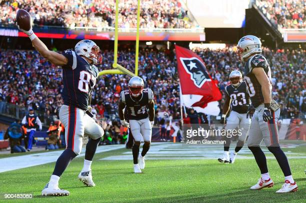 Rob Gronkowski of the New England Patriots spikes the ball after catching a touchdown pass during the third quarter of a game against the Miami...