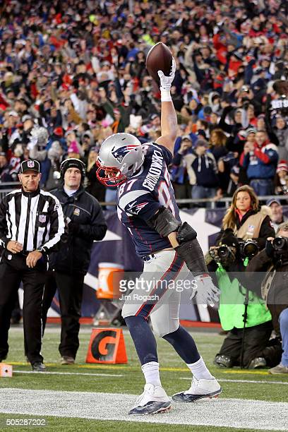 Rob Gronkowski of the New England Patriots spikes the ball after scoring his second touchdown against the Kansas City Chiefs in the third quarter...