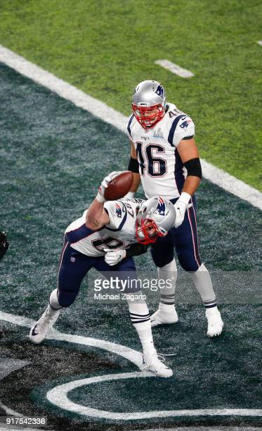 Rob Gronkowski of the New England Patriots spikes the ball after scoring on a fiveyard touchdown reception during the game against the Philadelphia...