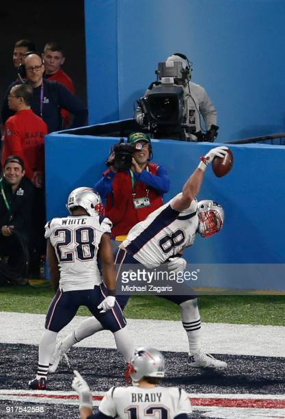Rob Gronkowski of the New England Patriots spikes the ball after scoring on a fouryard touchdown reception during the game against the Philadelphia...