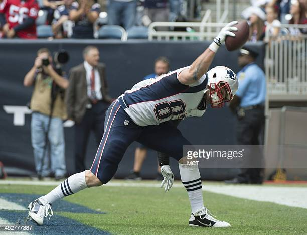 Rob Gronkowski of the New England Patriots spikes the ball after scoring against the Houston Texans in the first half of their game on Sunday Dec 1...