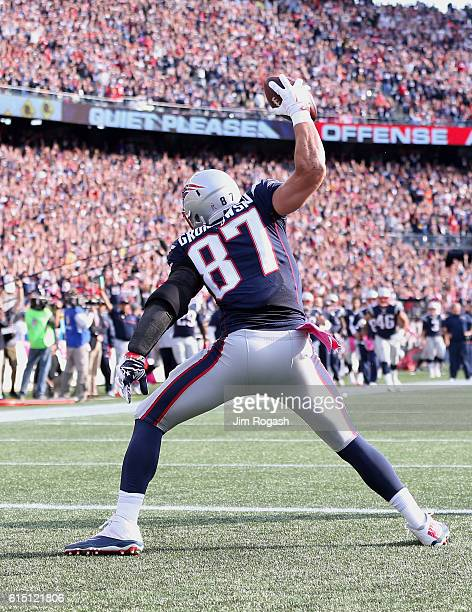 Rob Gronkowski of the New England Patriots spikes the ball after scoring against the Cincinnati Bengals in the third quater at Gillette Stadium on...
