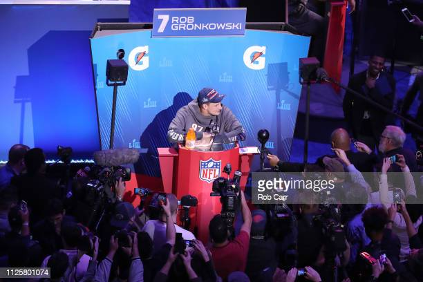 Rob Gronkowski of the New England Patriots talks to the media during Super Bowl LIII Opening Night at State Farm Arena on January 28 2019 in Atlanta...