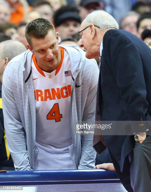 Rob Gronkowski of the New England Patriots talks with head coach Jim Boeheim of the Syracuse Orange prior to the game against the Duke Blue Devils at...