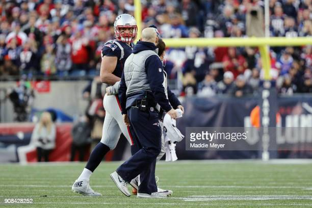 Rob Gronkowski of the New England Patriots walks off the field after an injury in the second quarter during the AFC Championship Game against the...