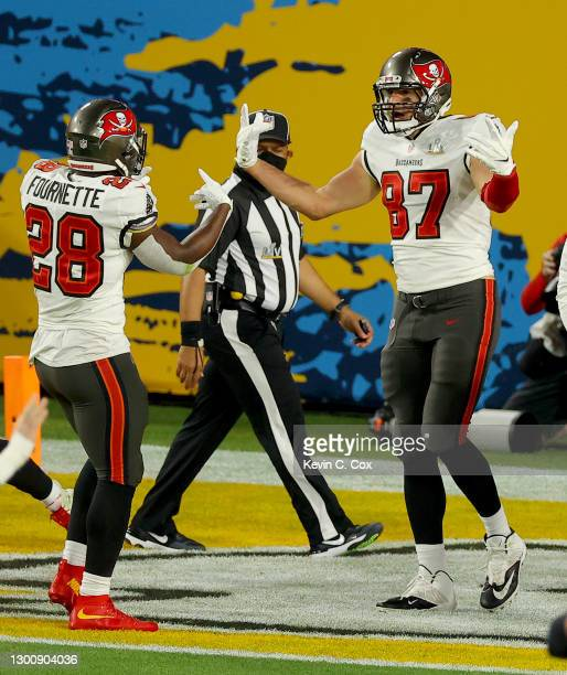 Rob Gronkowski of the Tampa Bay Buccaneers celebrates after an 8 yard touchdown with Leonard Fournette in the first quarter against the Kansas City...