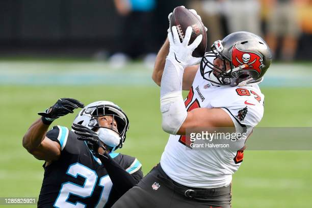 Rob Gronkowski of the Tampa Bay Buccaneers makes a catch in front of Jeremy Chinn of the Carolina Panthers during their NFL game at Bank of America...