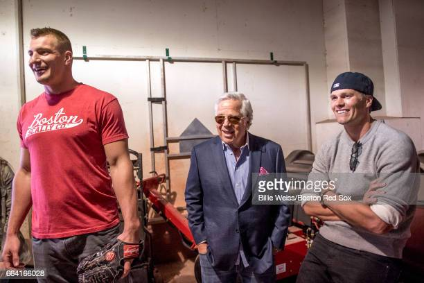 Rob Gronkowski owner Robert Kraft and Tom Brady of the New England Patriots react below the stadium before a pregame ceremony before the Boston Red...