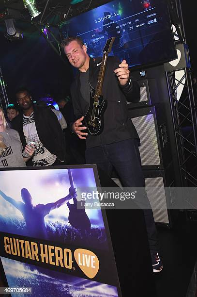 Rob Gronkowski plays Guitar Hero Live at the revealing of the AllNew Guitar Hero Live game by Activision on April 14 2015 in New York City