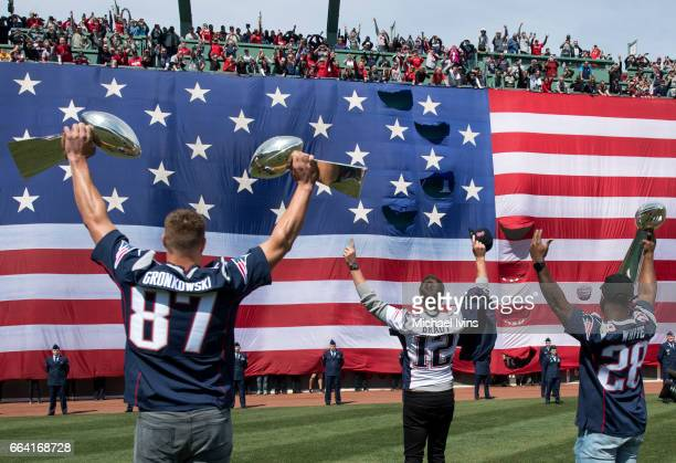 Rob Gronkowski Tom Brady and James White of the New England Patriots take the field after being introduced during a ceremony in recognition of their...