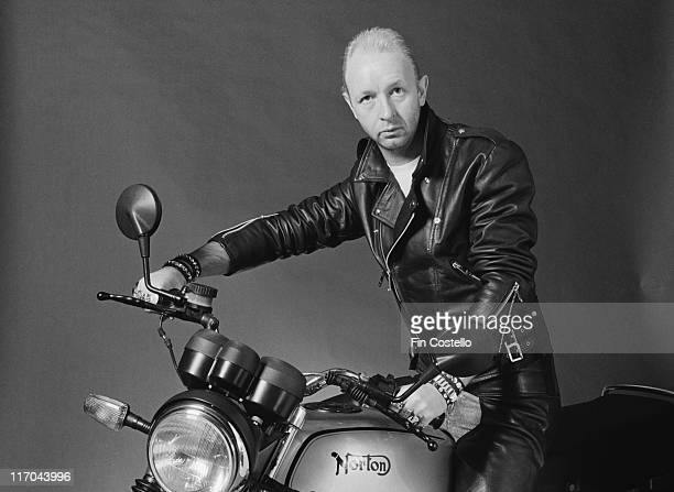 Rob Halford British singersongwriter with heavy metal band Judas Priest posing on a Norton motorcycle on the Southbank London England Great Britain...
