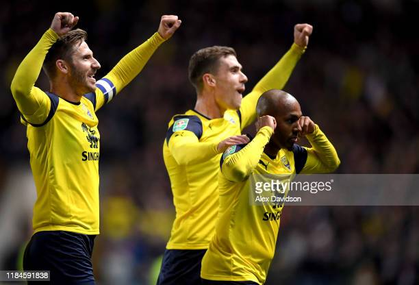 Rob Hall of Oxford United celebrates scoring his sides first goal with James Henry and Josh Ruffels during the Carabao Cup Round of 16 match between...