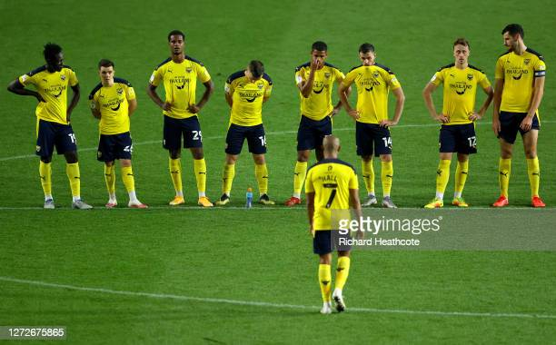 Rob Hall of Oxford United walks back to his teammates dejected after his penalty the third in the shootout is saved during the Carabao Cup Second...