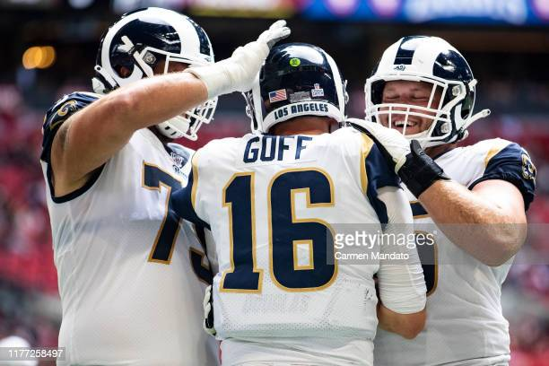 Rob Havenstein and Brian Allen celebrate Jared Goff of the Los Angeles Rams scoring a rushing touchdown during the second half of a game at...