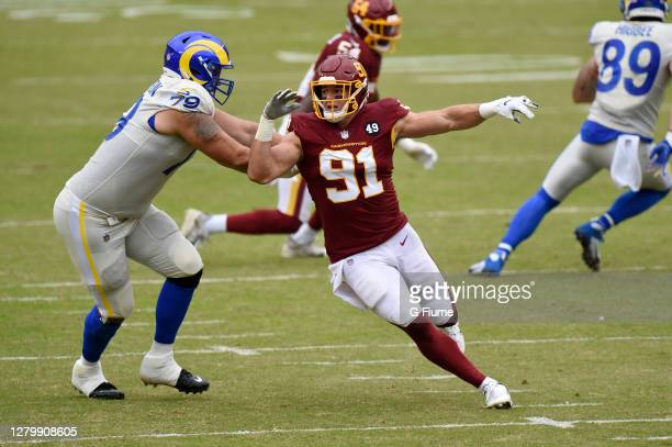 Rob Havenstein of the Los Angeles Rams blocks against Ryan Kerrigan of the Washington Football Team at FedExField on October 11, 2020 in Landover,...