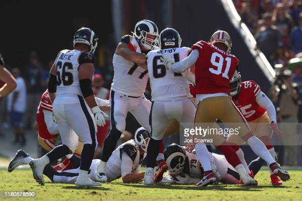 Rob Havenstein of the Los Angeles Rams jumps on a loose ball in the fourth quarter against the San Francisco 49ers at Los Angeles Memorial Coliseum...