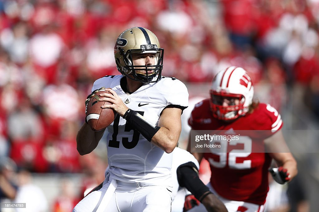 Rob Henry #15 of the Purdue Boilermakers looks to pass the ball against the Wisconsin Badgers during the game at Camp Randall Stadium on September 21, 2013 in Madison, Wisconsin.