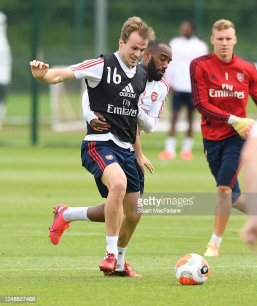 Rob Holding and Alex Lacazette of Arsenal during a training session at London Colney on June 09, 2020 in St Albans, England.