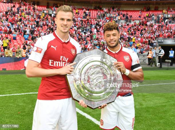 Rob Holding and Alex OxladeChamberlain of Arsenal after the FA Community Shield match between Chelsea and Arsenal at Wembley Stadium on August 6 2017...