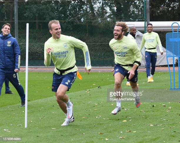 Rob Holding and Calum Chambers of Arsenal during a training session at London Colney on September 27 2020 in St Albans England