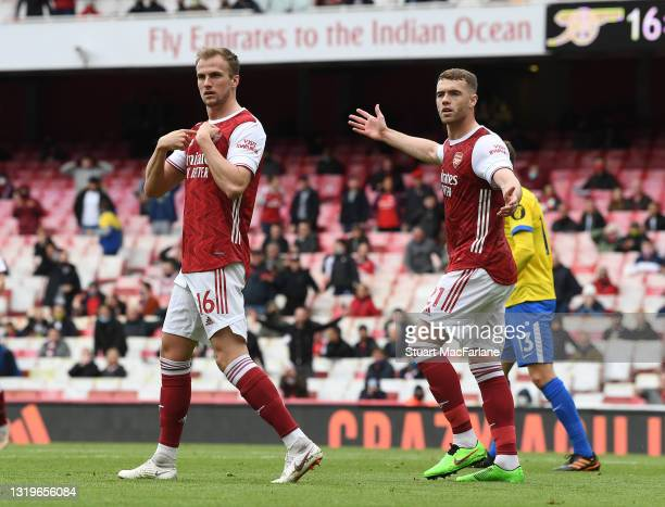 Rob Holding and Calum Chambers of Arsenal during the Premier League match between Arsenal and Brighton & Hove Albion at Emirates Stadium on May 23,...