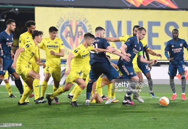 Rob Holding and Calum Chambers of Arsenal hold off the Villarreal defenders during the UEFA Europa League Semi-final First Leg match between...