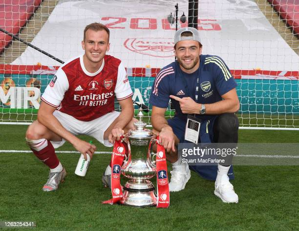 Rob Holding and Calum Chamers of Arsenal after the FA Cup Final match between Arsenal and Chelsea at Wembley Stadium on August 01 2020 in London...