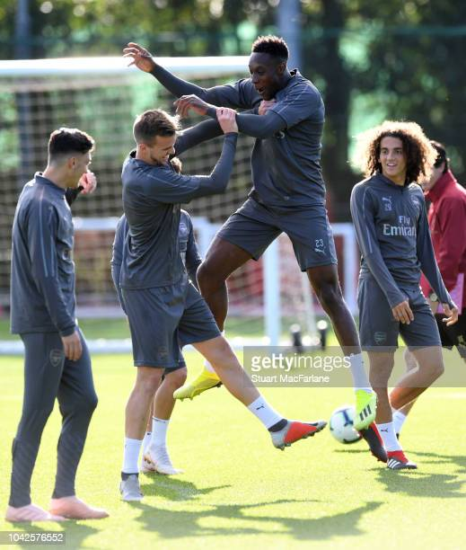 Rob Holding and Danny Welbeck of Arsenal during a training session at London Colney on September 28 2018 in St Albans England