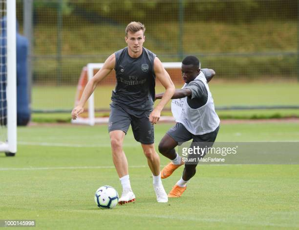 Rob Holding and Eddie Nketiah of Arsenal during a training session at London Colney on July 16 2018 in St Albans England