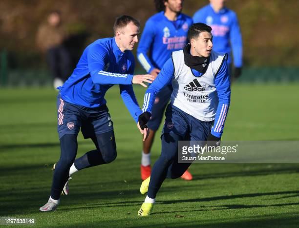 Rob Holding and Gabriel Martinelli of Arsenal during a training session at London Colney on January 22, 2021 in St Albans, England.