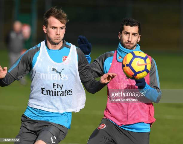 Rob Holding and Henrikh Mkhitaryan of Arsenal during a training session at London Colney on February 2 2018 in St Albans England