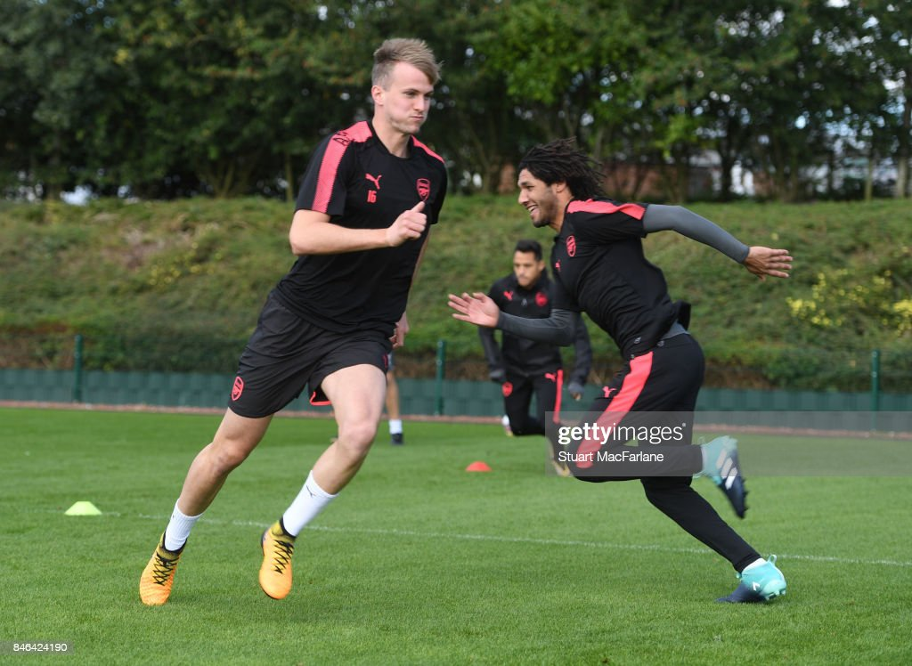Rob Holding and Mohamed Elneny of Arsenal during a training session at London Colney on September 13, 2017 in St Albans, England.