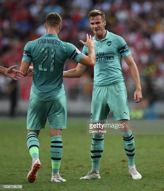 Rob Holding celebrates scoring a goal for Arsenal with Calum Chambers during the International Champions Cup match between Arsenal and Paris Saint...