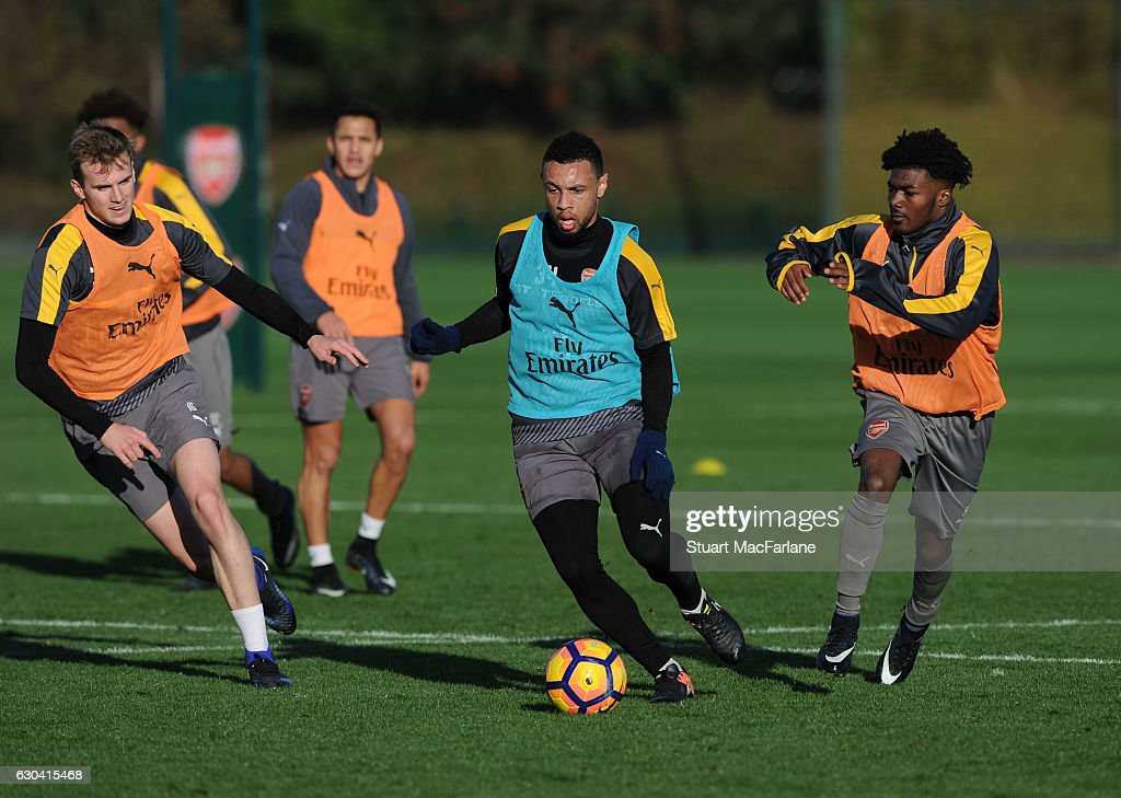 Rob Holding, Francis Coquelin and Ainsley Maitland-Niles of Arsenal during a training session at London Colney on December 22, 2016 in St Albans, England.