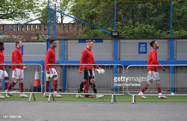 Rob Holding, Gabriel, Bernd Leno and captain Pierre-Emerick Aubameyang of Arsenal walk to the stadium before the Premier League match between Chelsea...