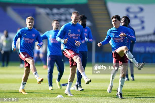 Rob Holding, Hector Bellerin and teammates warm up prior to the Premier League match between Leicester City and Arsenal at The King Power Stadium on...